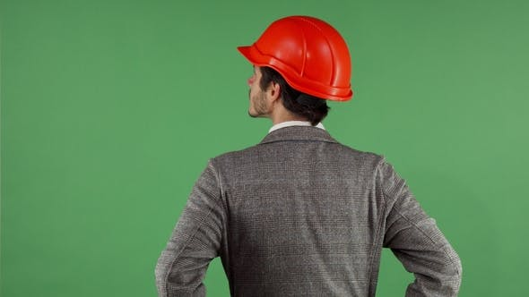 Thumbnail for Rear View Shot of a Contactor Wearing Hardhat Looking Around on Chromakey