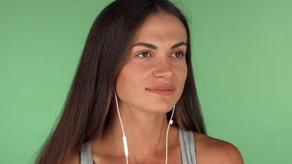 Cover Image for Young Woman Enjoying Listening To Music on Chromakey