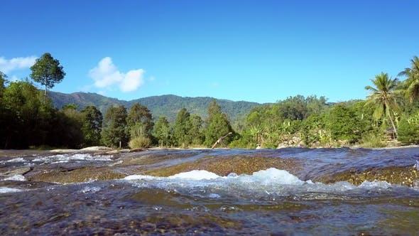 Thumbnail for Water Boils on Rapids Against Pictorial Landscape