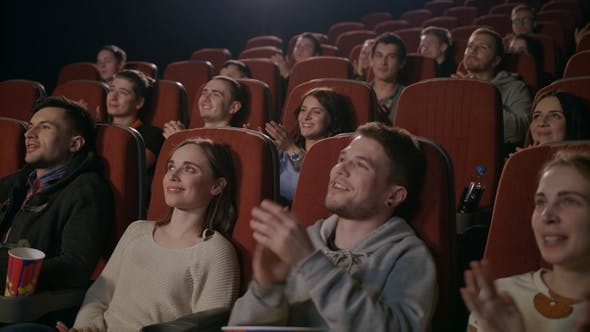 Funny Spectators Applaud in Theater. People Clapping Hands at Theater