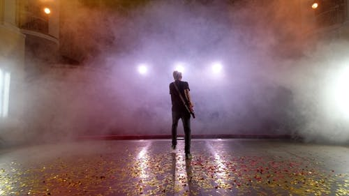 The Guitarist Performs on Stage. Stage Light, Smoke