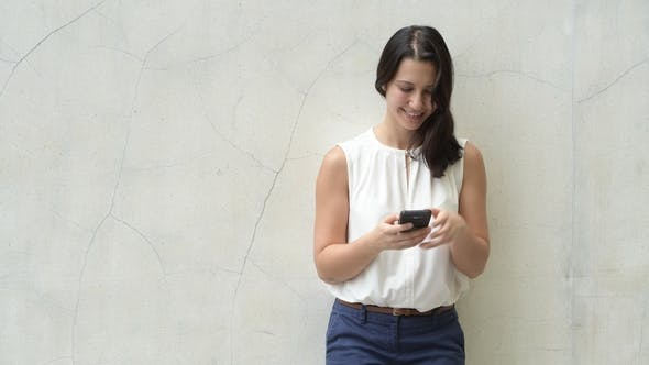 Thumbnail for Portrait Of Beautiful Young Happy Woman Outdoors Using Mobile Phone