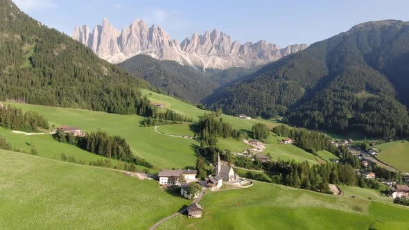 Aerial view of famous Church of Santa Maddalena in Dolomites mountains, Italy