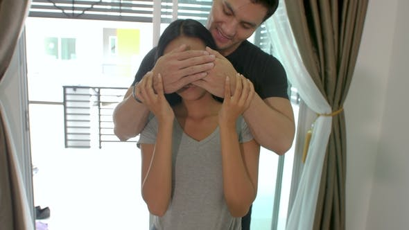 Thumbnail for Happy Romantic Couple, Young Man Surprises His Partner By Showing Her New House