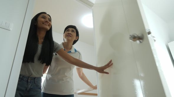 Thumbnail for Happy Asian Women LGBT Lesbian Couple Moves Into a New Apartment.