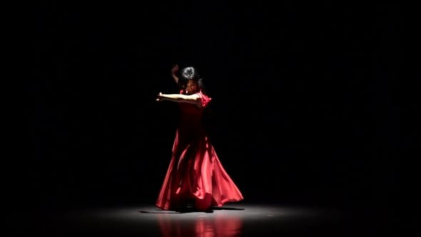 Thumbnail for Girl in Dress the Dark Room Performs Elegant Movements with Her Hands in Dance