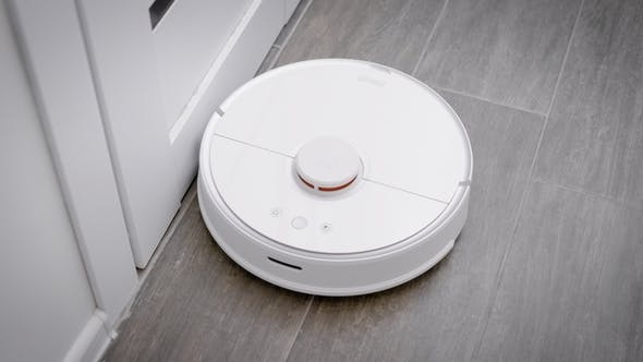 Thumbnail for in the Frame Is a Robot Vacuum Cleaner That Cleans the Floor in the Kitchen