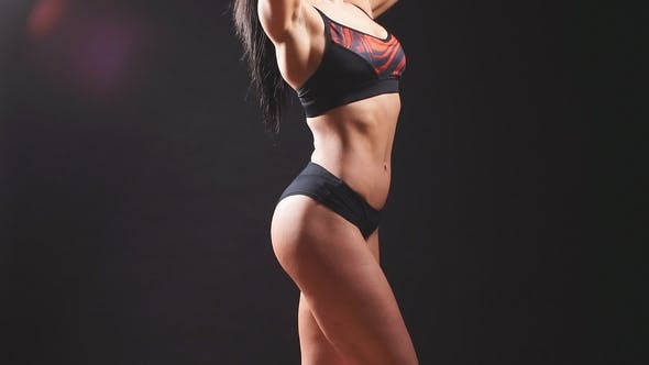 Thumbnail for Portrait of Young Beautiful Fitness Woman, Isolated on Black Background