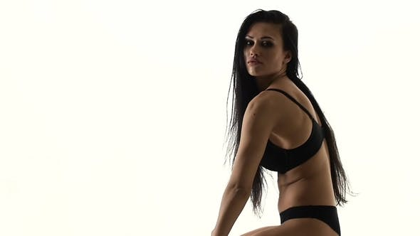 Thumbnail for Stripper with Piercing in the Navel . Black Background