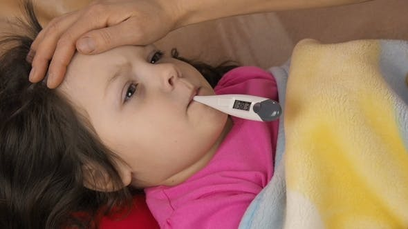 A Child with a Thermometer