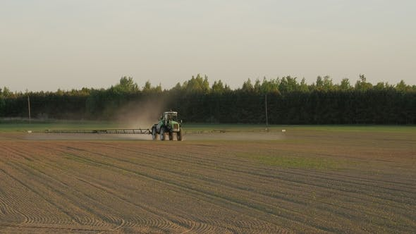 Thumbnail for Tractor Spray Field with Chemicals for Crop Plants Protection From Weed and Pest
