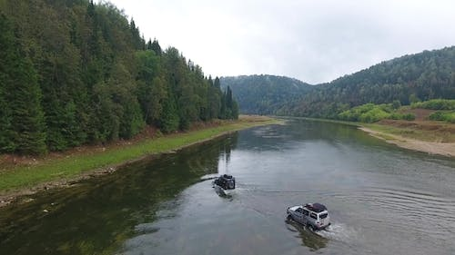 Jeep Rides the River. Mountain. Forest. Ural.