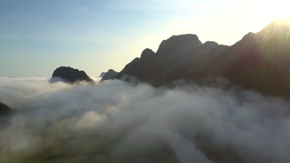 Thumbnail for Calm River Under Foggy Clouds Against Hills Before Sunrise