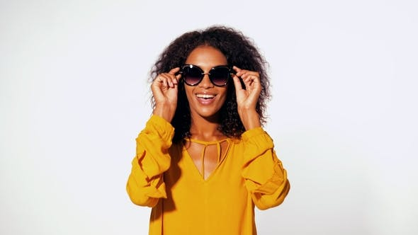 Thumbnail for Happy African American Woman with Afro Hair in Yellow Top