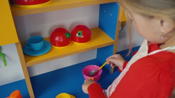 Thumbnail for Little Girl Playing in Cooking Food