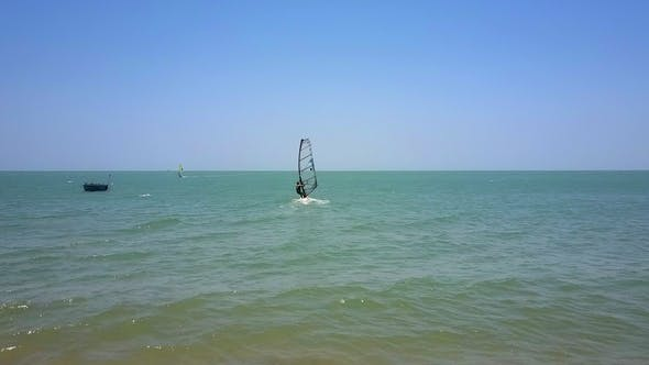 Thumbnail for Windsurfer with Transparent Sail Starts Moving From Beach