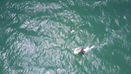Surfer Rides Gleaming Azure Ocean Waves