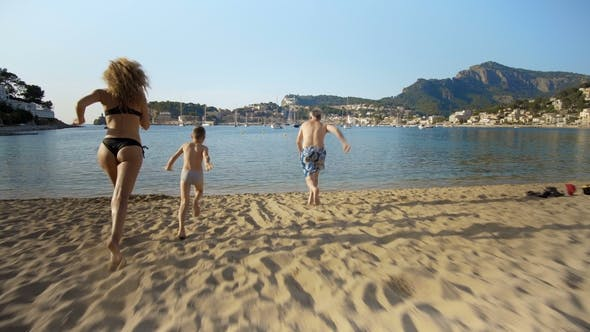 Thumbnail for Family Running to the water at the beach