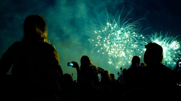 Thumbnail for Crowd of People Looks at the Fireworks at Night. Multicolored Pyrotechnic Show on the Holiday