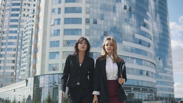 Thumbnail for Confident Business Women Walking Down the Street