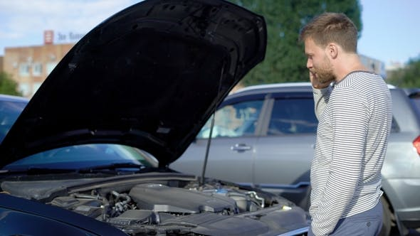 Thumbnail for The Man Is Calling a Car Repair Service. The Hood Is Open, the Car Will Not Start