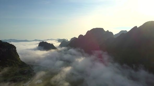 Thumbnail for Endless Highland River Valley Covered with Fog