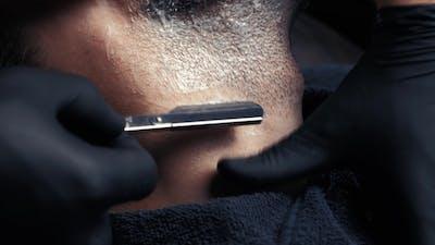 Barber Shaving with a Danger Razor