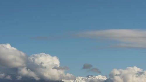 Thick Clouds Swirling Over Mountain Range