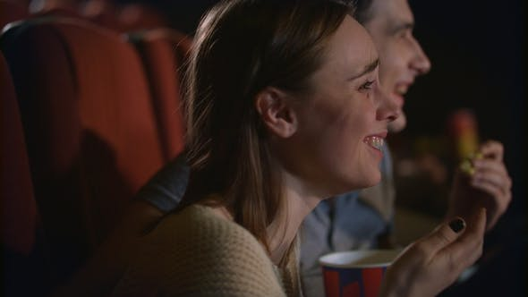 Thumbnail for Young Couple Enjoying Film in Cinema