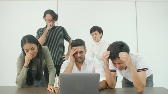 Thumbnail for Creative Business Team Getting Very Bad News on His Laptop
