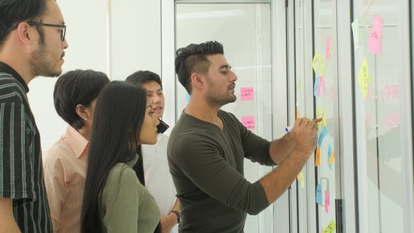 Thumbnail for Business Team Brainstorming Ideas with Sticky Notes