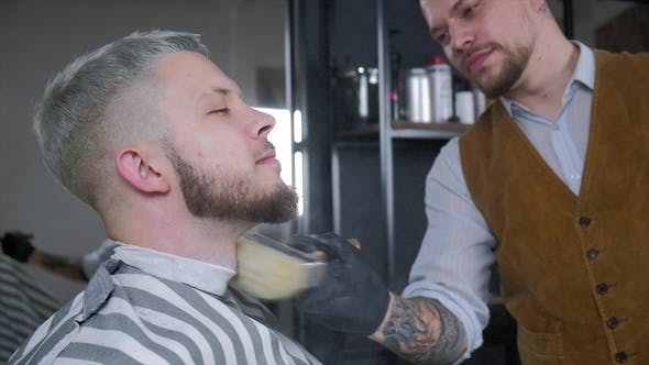 Thumbnail for Barber Sips Talc on a Brush. The Video Has a Brown Tint.