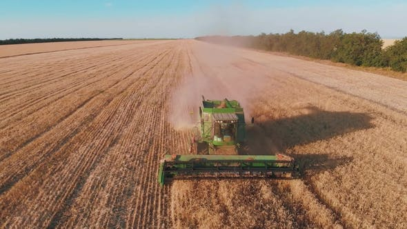 Thumbnail for Aerial View of a Combine Harvester Working in a Field at Sunset