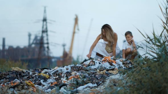 Thumbnail for Mom and Son. Garbage Dump. Industrial Factory on a Background. Enviroment Pollution Concept