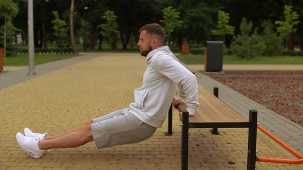 Man Is Doing Reverse Push-ups