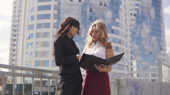 Thumbnail for Informal Meeting of Business Partners on the Background of the Business Center. Two Business Women