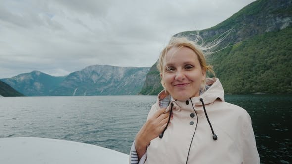 Thumbnail for Portrait of a Happy Woman Sailing on a Cruise Ship on a Beautiful Fjord in Norway