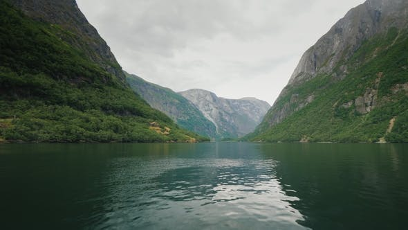 Thumbnail for Fly Low Over the Surface of the Water in the Picturesque Fjord of Norway