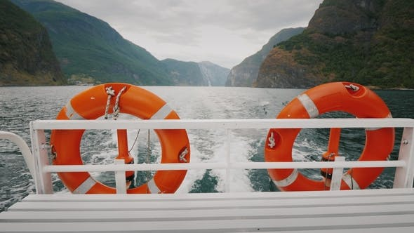 Thumbnail for Cruise Ship Cruise with Two Lifebuoys. In the Background, the Picturesque Norwegian Fjord