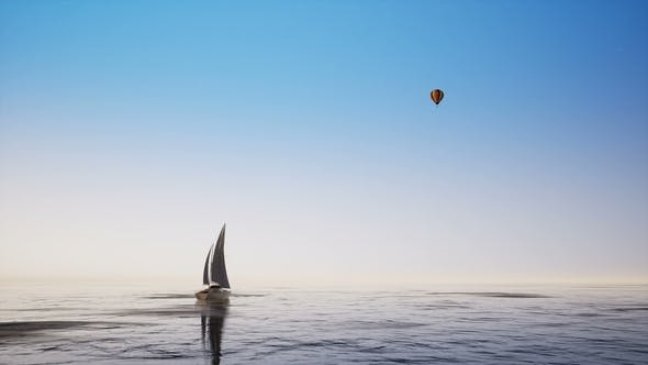 Sailboat and Balloon Against the Blue Sky