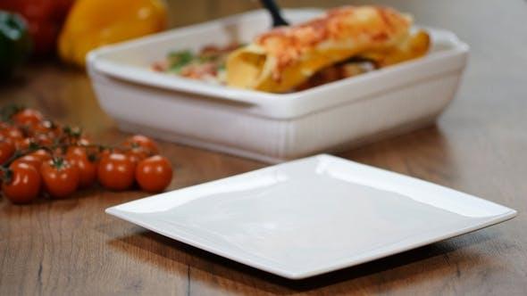 Thumbnail for Homemade Chicken Enchiladas in a White Plate