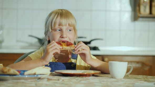 Cover Image for A Little Girl with an Appetite Eating Pizza in the Kitchen