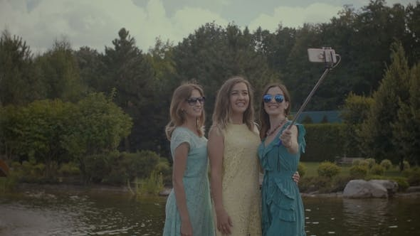 Thumbnail for Tourist Women Taking Selfie with Cellphone and Monopod