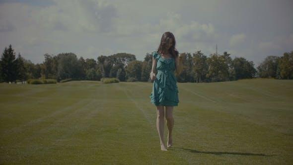 Thumbnail for Joyful Barefoot Woman Walking on Green Grass Field