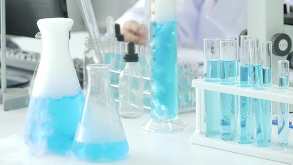Thumbnail for Blue Chemical Substance With Smoke Boils In Laboratory