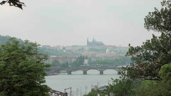 Thumbnail for Beautiful View on Prague City, Vltava River and Bridges, Trees Branches Are in Sides