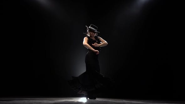 Thumbnail for Flamenco. Girl Is Dancing a Spanish Incendiary Dance. Black Background. Llight From Behind