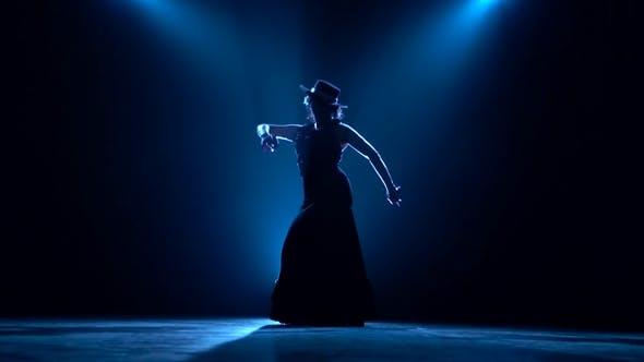 Girl Dances Flamenco. Blue Background. Silhouette