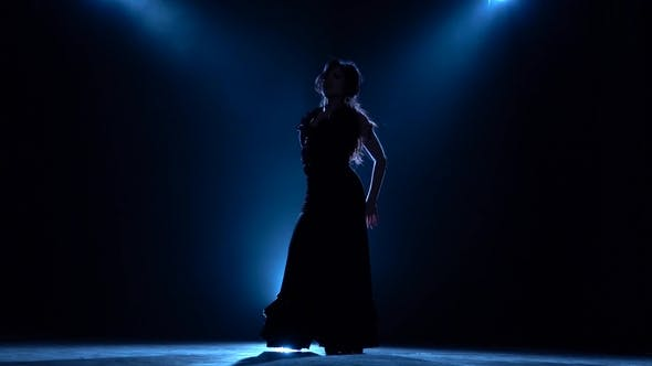 Thumbnail for Dancer Performs Professional Flamenco Movements. Llight From Behind. Smoke Background. Silhouette