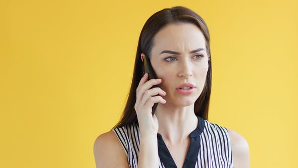 Displeased Woman Speaking on Phone
